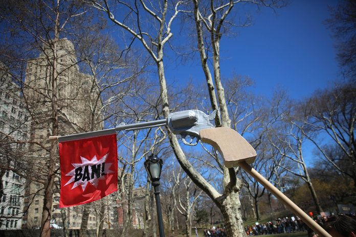 Становано in N.Y.C., a pistol with a bang flag ironically reads,