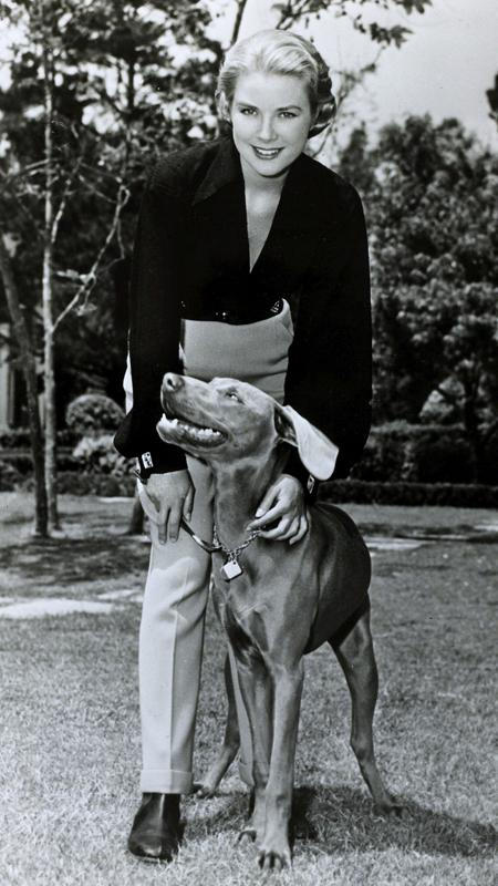 Јануар 1956, American actress Grace Kelly, pictured with her dog