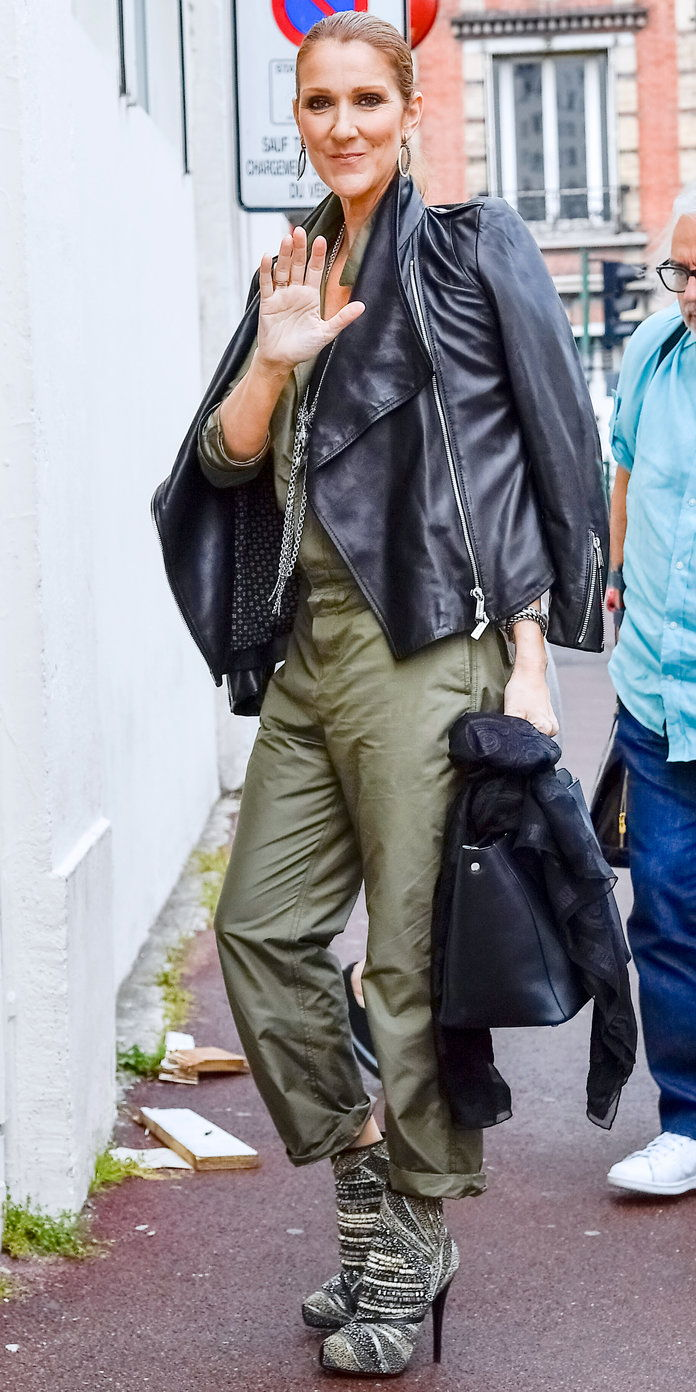 في A MILITARY GREEN JUMPSUIT AND SPORTY LEATHER