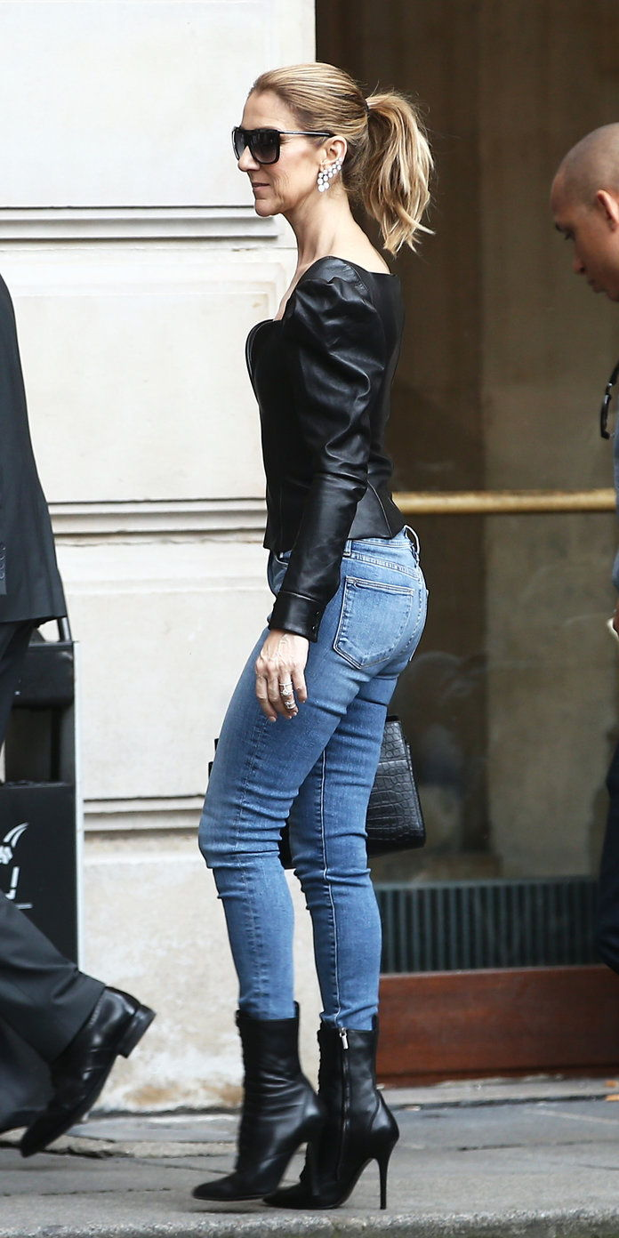 في a leather top and jeans
