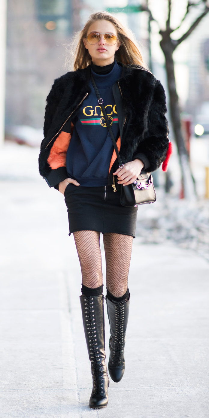 Ромее Strijd in a Gucci sweatshirt