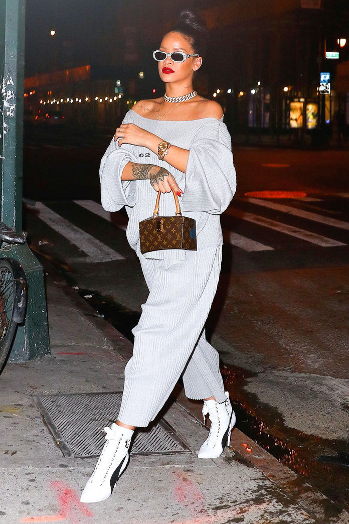Ан off-the-shoulder sweatsuit is instantly sexy paired with stilettos.