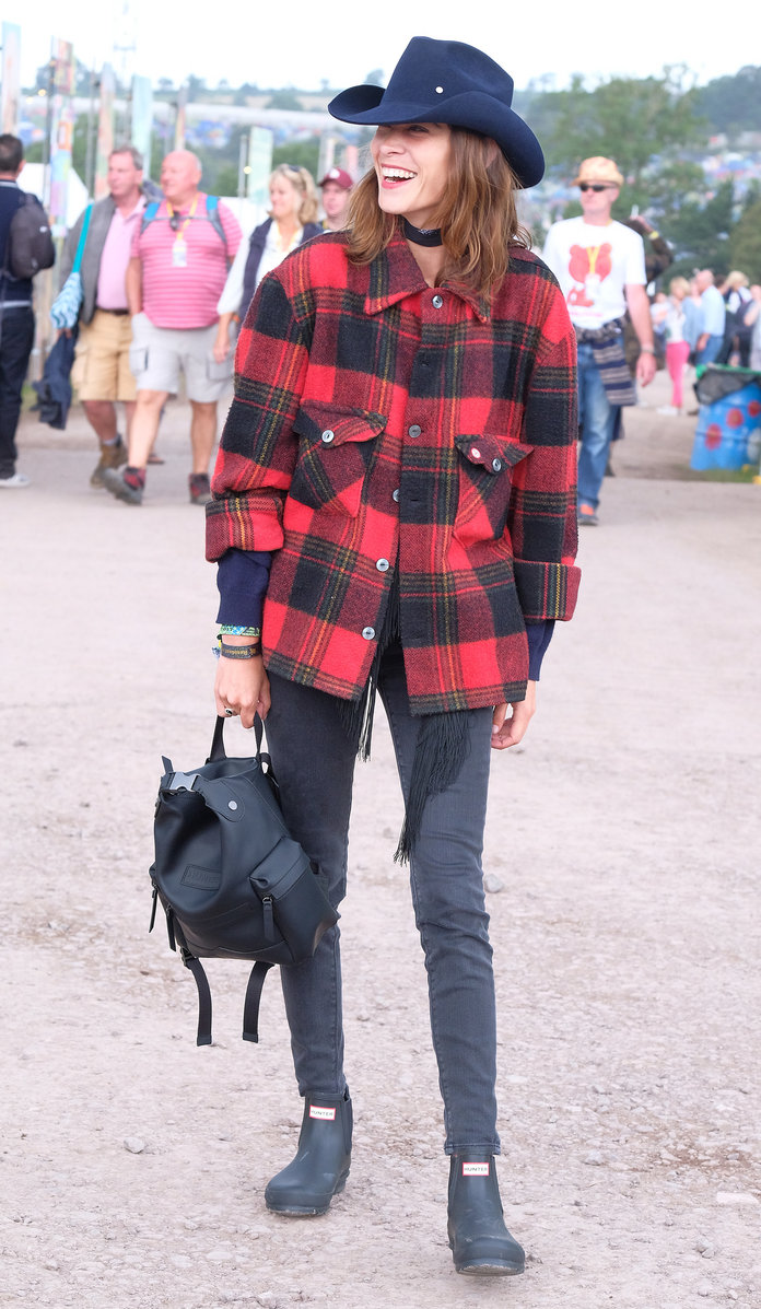 Алека Chung lassoes a western look together for Glastonbury with Hunter Originals backpack and boots.