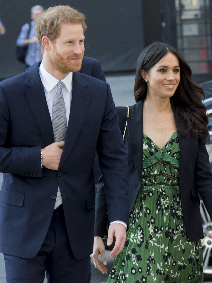 Принце Harry and Meghan Markle lead